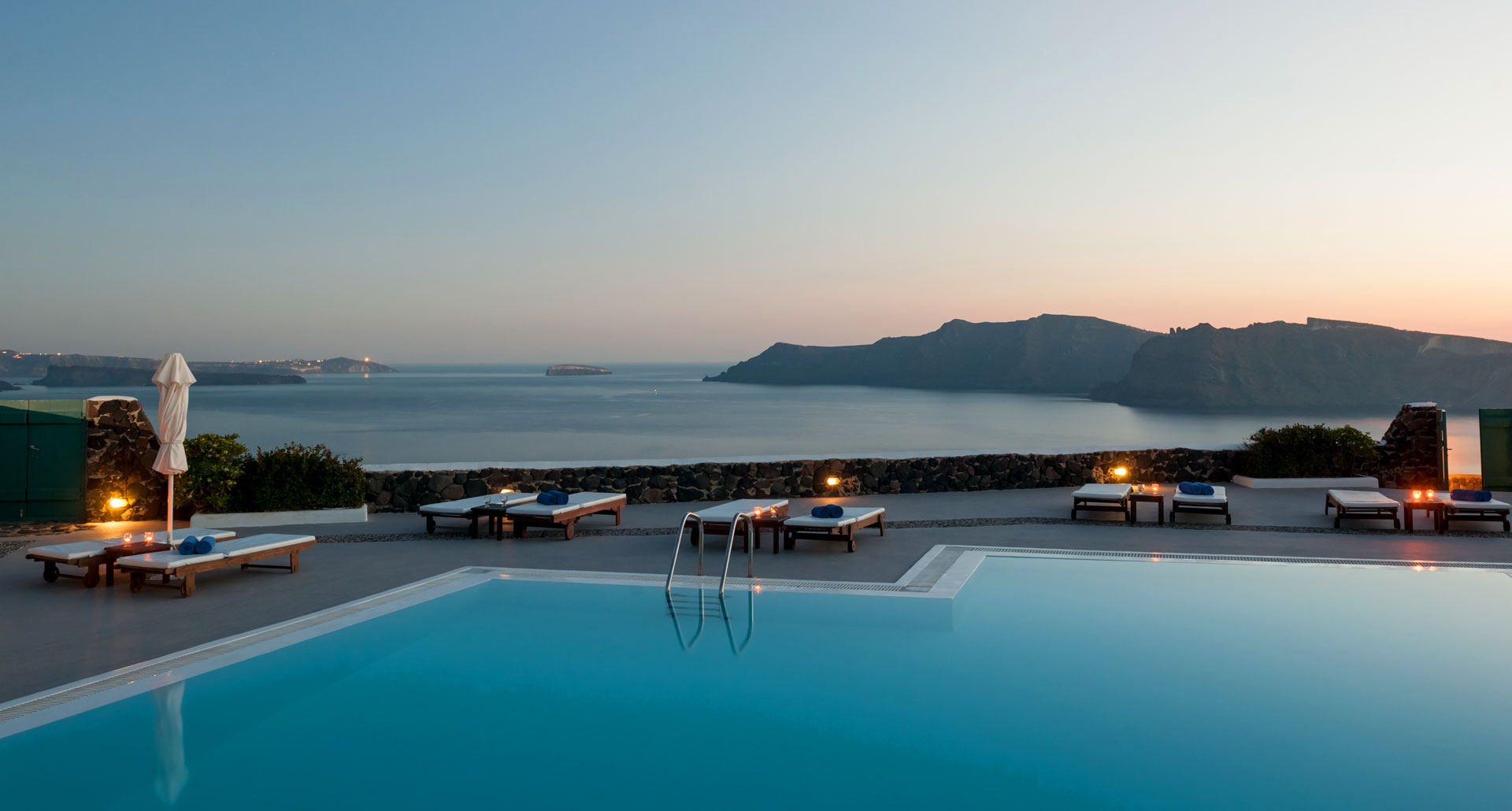 Evening by the pool at Strogili Hotel Apartments in Santorini
